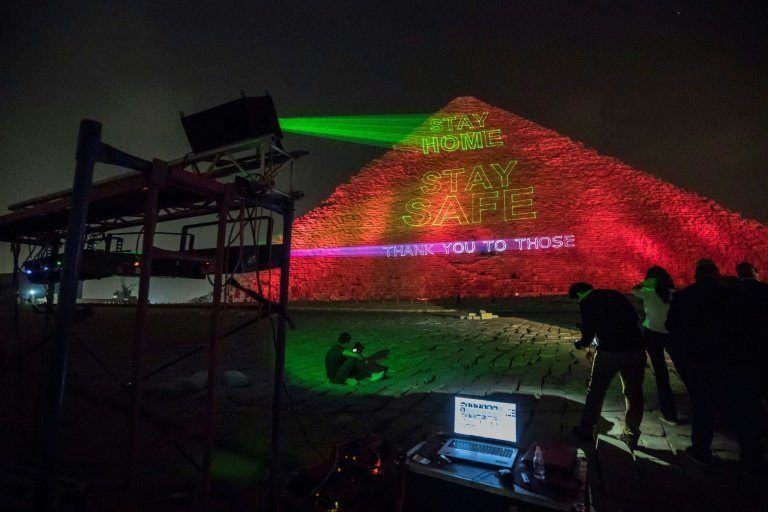 A call to stay home by lighting the pyramid